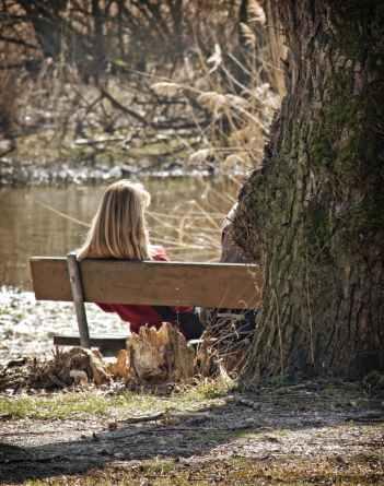 alone bench person river