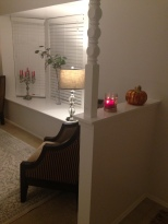 Our lamps, candles and a tiny section in honor of the season changing. There is also a small wreath that hangs on the front door that is not pictured.