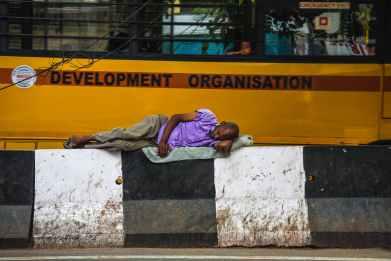 man lying on barricades